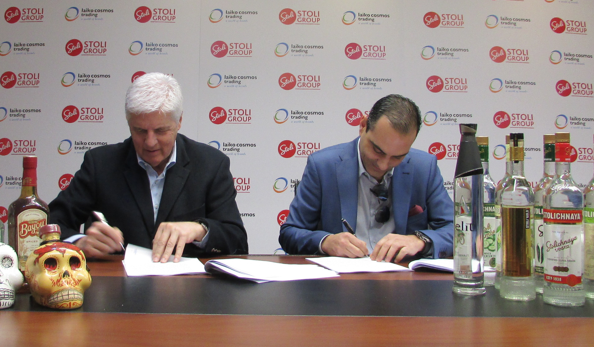 V.Petrides and A.Ioannides signing the agreement